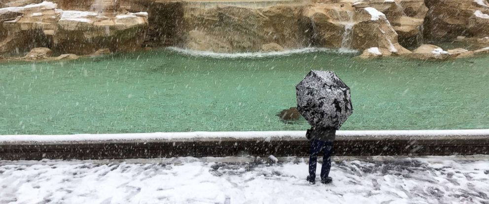 PHOTO: A man looks at the Trevi Fountain during a snowfall, in Rome, Feb. 26, 2018.
