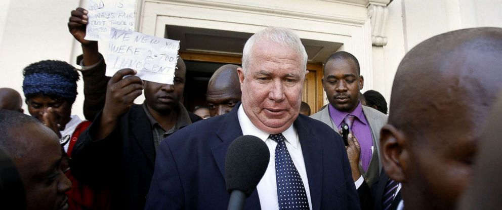 PHOTO: Zimbabwean Movement for Democratic Change (MDC) party treasurer Roy Bennett answers questions from journalists as he leaves the High Court of Zimbabwe in Harare, May 10, 2010.
