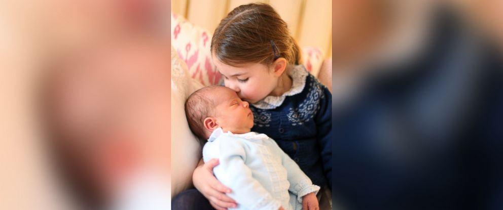 PHOTO: A photo made available by Kensington Palace on May 5,2018 and taken by Catherine, Duchess of Cambridge shows her daughter Princess Charlotte kissing her brother Prince Louis on her third birthday in London, May 2, 2018.