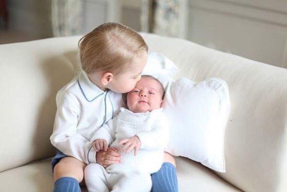 PHOTO: Prince George kissing the forehead of his sister, Princess Charlotte in a photograph released by Prince William and Princess Kate after Charlottes birth in 2015 at their Anmer Hall home.