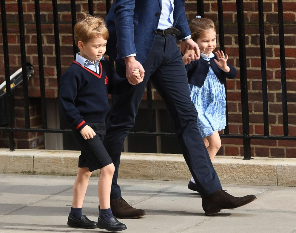 PHOTO: Princess Charlotte waving as her father Prince William takes her and her brother, Prince George to see their new baby brother, April 23, 2018.