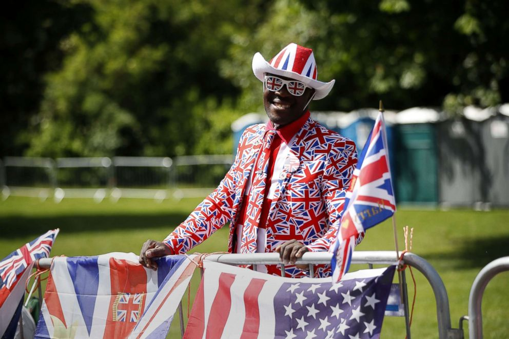 Royal fan Joseph Afrane, bedecked in a Union flag pattern, poses along the Long Walk in Windsor on May 18, 2018, the day before the Royal wedding.