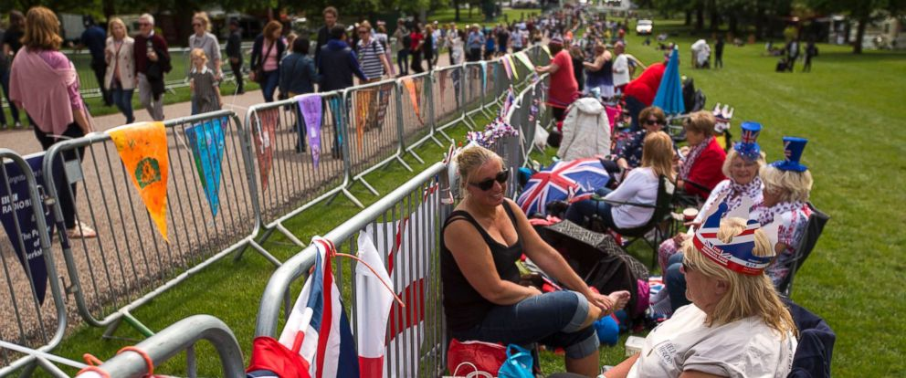 PHOTO: People sit along the Long walk ahead of the wedding of Prince Harry and Meghan Markle in Windsor, England, May 18, 2018.