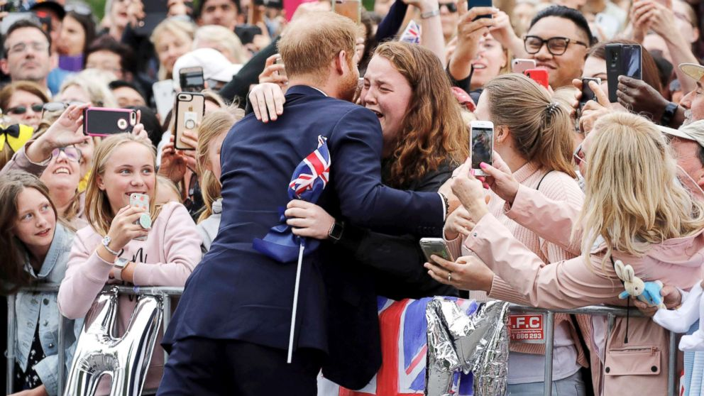 Britain's Prince Harry hugs a member of the public as he arrives at the Royal Botanic Gardens in Melbourne, Australia, Oct. 18, 2018.