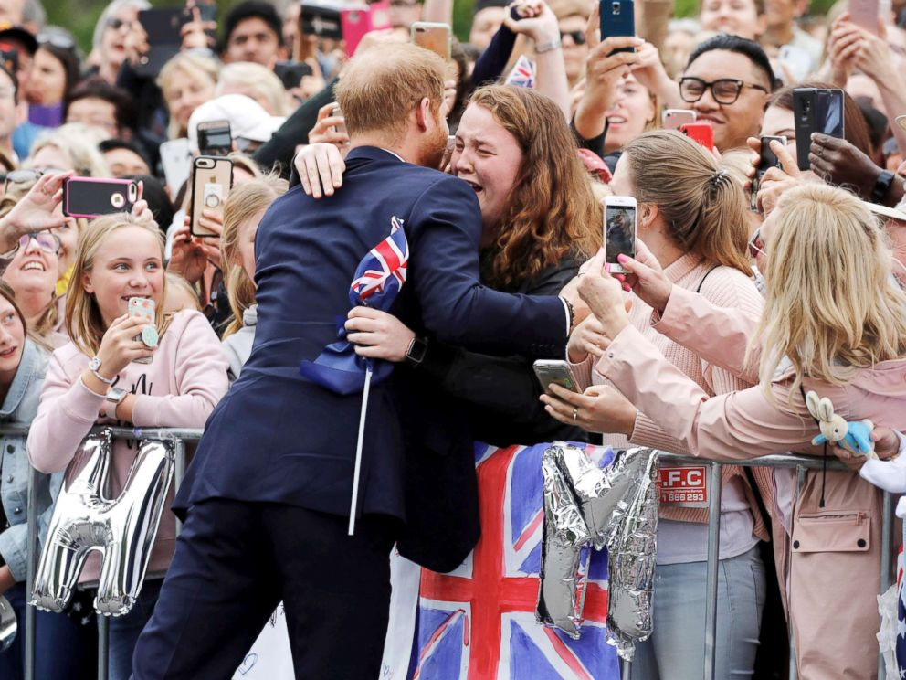 PHOTO: Britains Prince Harry hugs a member of the public as he arrives at the Royal Botanic Gardens in Melbourne, Australia, Oct. 18, 2018.