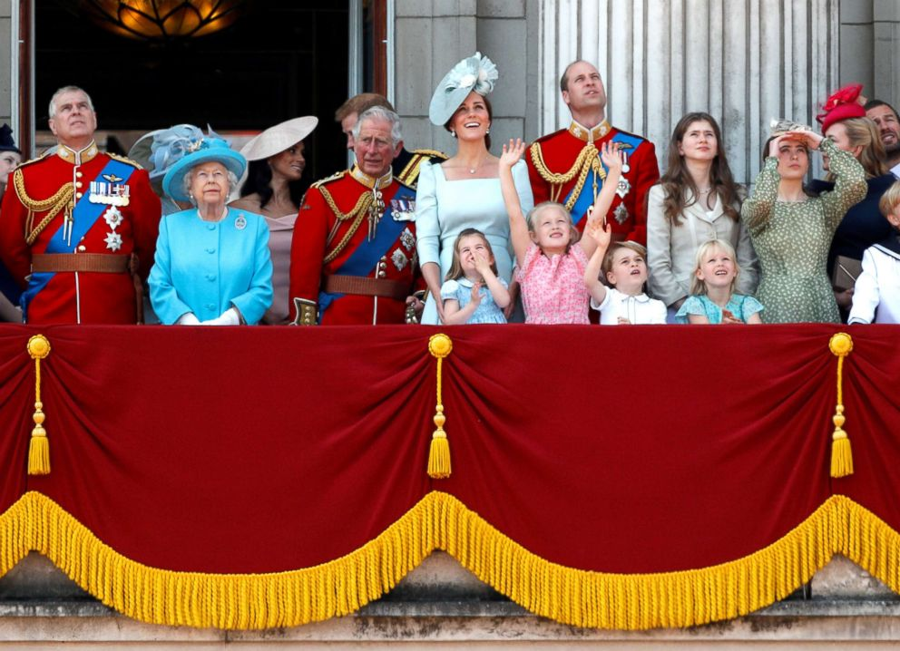 PHOTO: Britains Queen Elizabeth and members of the British royal family, look up at the RAF flypast from the balcony of Buckingham Palace as part of Trooping the Color parade in central London, June 9, 2018.