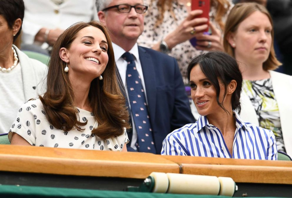 PHOTO: Catherine, Duchess of Cambridge and Meghan, Duchess of Sussex attend day twelve of the Wimbledon Lawn Tennis Championships at All England Lawn Tennis and Croquet Club on July 14, 2018 in London.