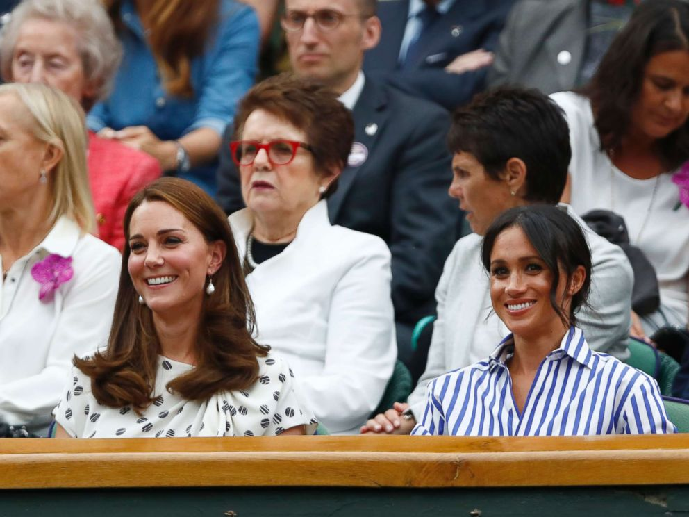 PHOTO: Catherine, Duchess of Cambridge and Meghan, Duchess of Sussex, right, sit in the Royal Box on Center Court at the Wimbledon Tennis Championships, in London, July 14, 2018.