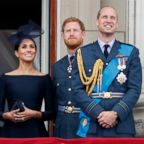Meghan, Duchess of Sussex, Prince Harry, Duke of Sussex, Prince William, Duke of Cambridge and Catherine, Duchess of Cambridge watch a flypast to mark the centenary of the Royal Air Force from the balcony of Buckingham Palace, July 10, 2018, in London.