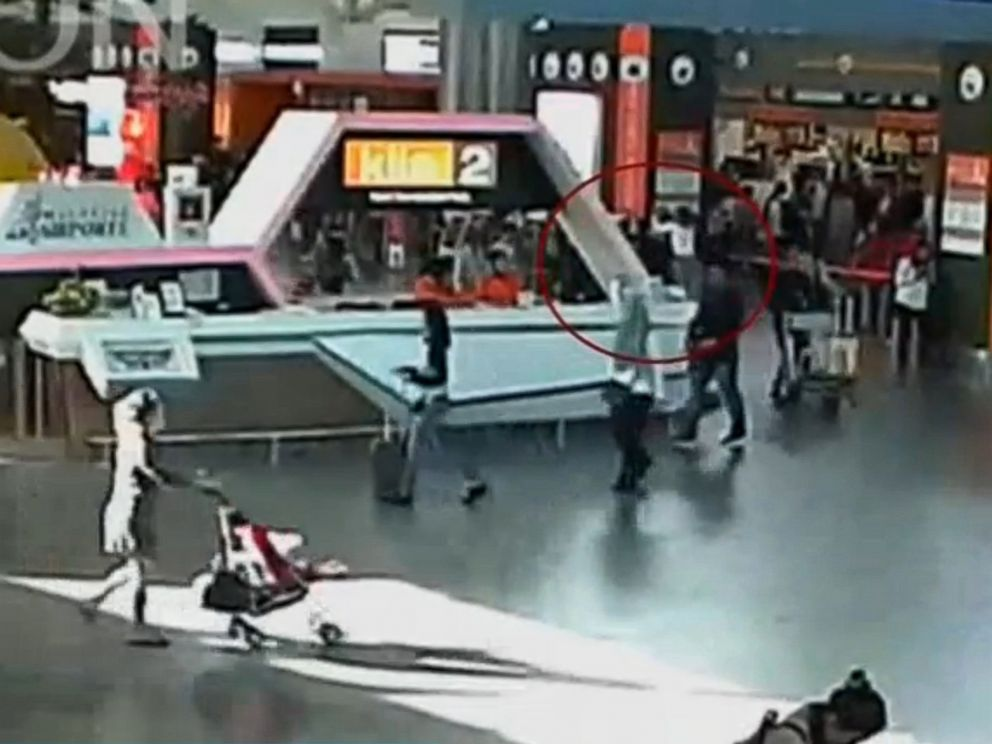 PHOTO: A still image from a CCTV footage appears to show (circled in red) Kim Jong Nam being accosted by a woman in a white shirt at Kuala Lumpur International Airport in Malaysia, Feb. 13, 2017.