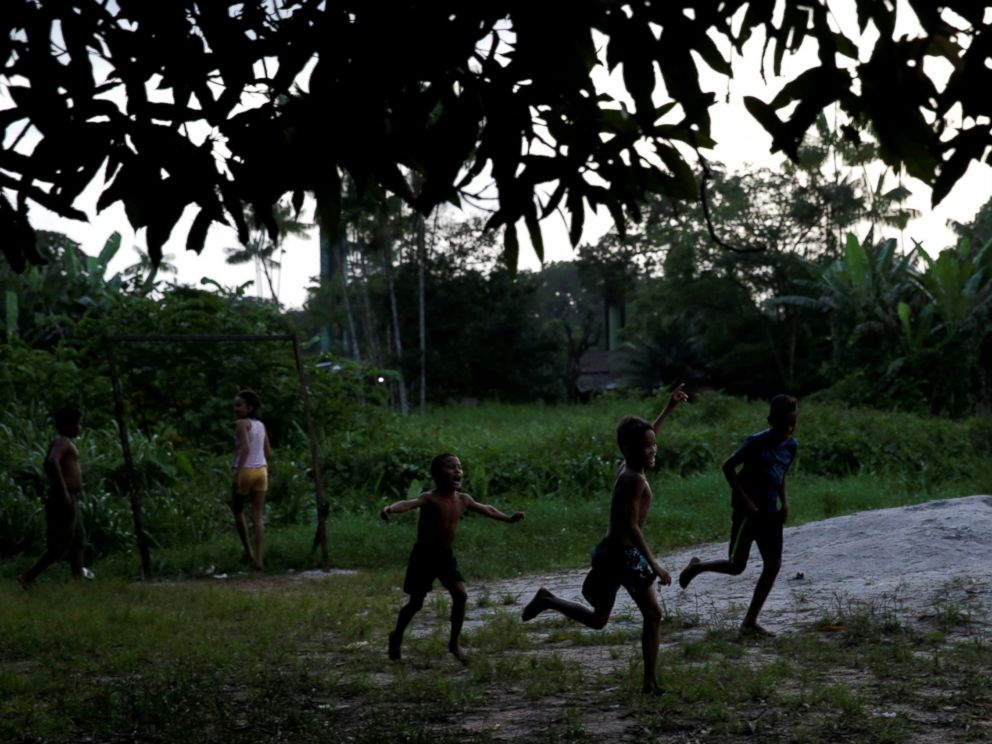 PHOTO: Boys celebrate a goal as they play soccer in Calcoene, northern Brazil, April 1, 2017.