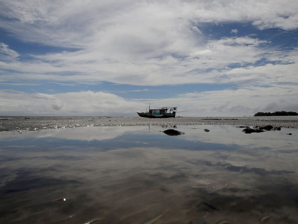 PHOTO: A boat stands during low tide at the mouth of the Calcoene River where it joins the Atlantic Ocean on the coast of Amapa state, northern Brazil, April 6, 2017.