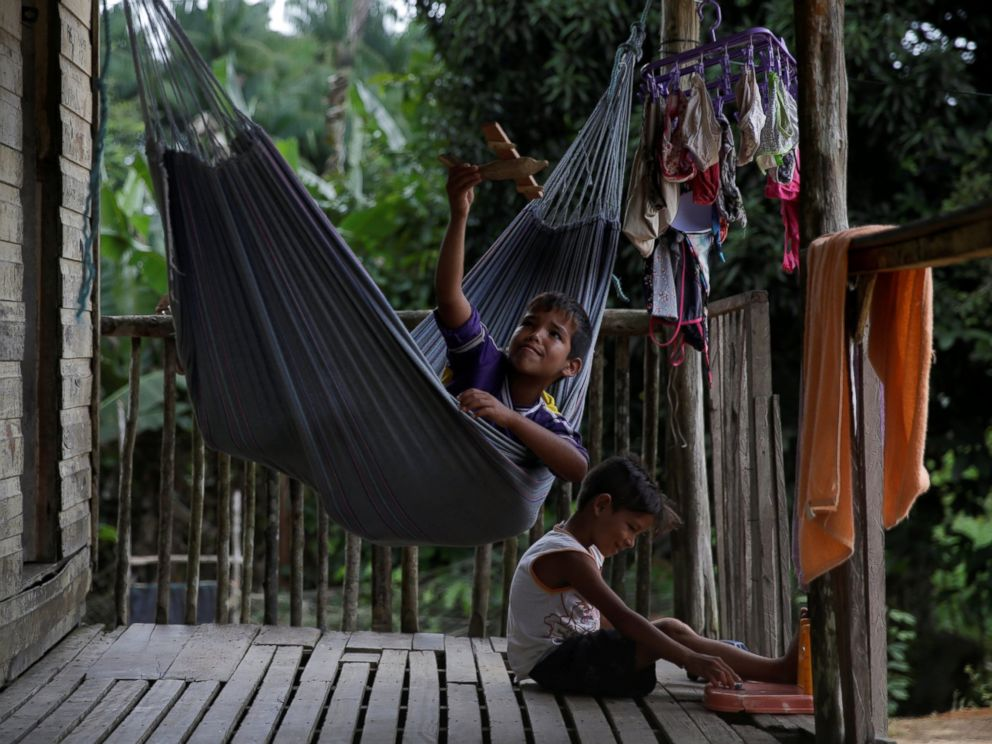 PHOTO: Marcos Paulo, an indigenous boy from the Karipuna tribe, plays in a hammock on the deck of his house on the banks of the Oiapoque River on the coast of Amapa state, near Oiapoque city, northern Brazil, April 4, 2017.