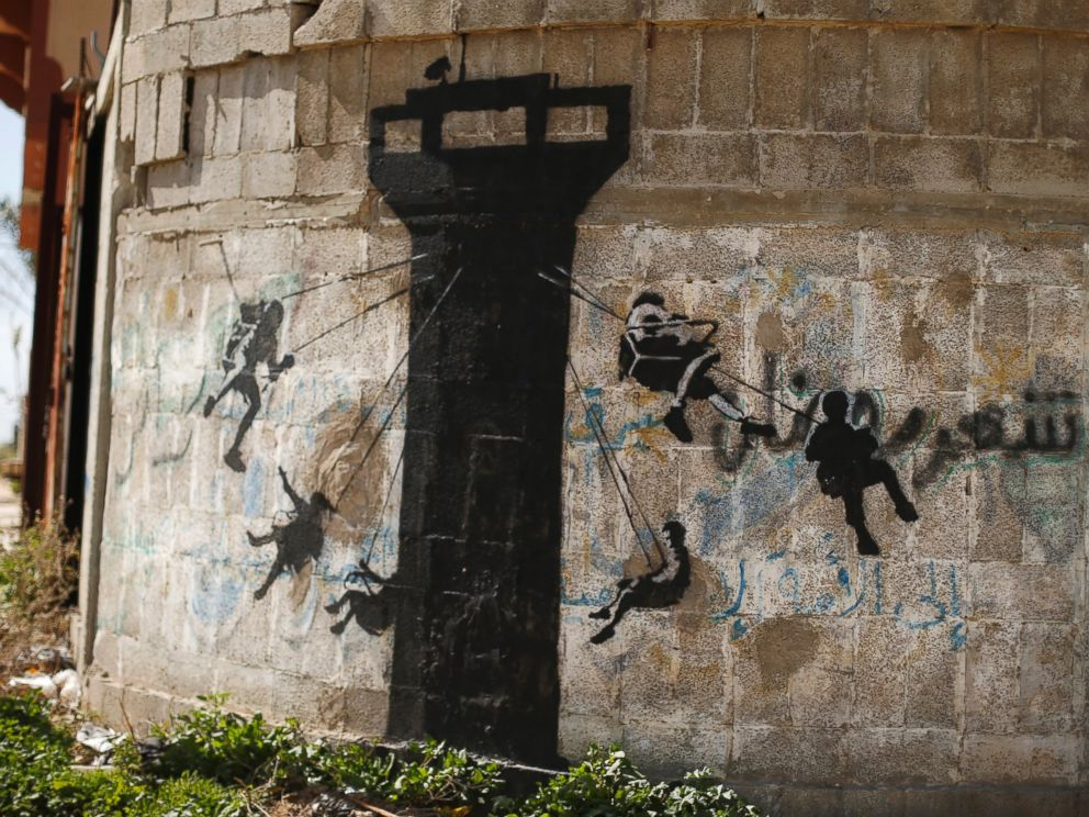 PHOTO: A mural, presumably painted by British street artist Banksy, is seen on a wall in Beit Hanoun town in the northern Gaza Strip, Feb. 26, 2015.