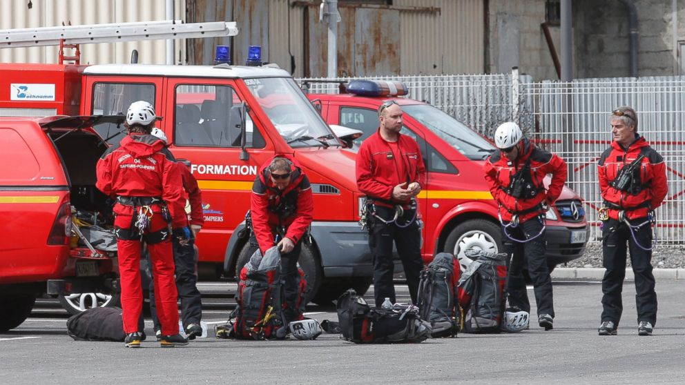 French firefighters prepare to take-off in Digne-les-Bains for the crash site of an Airbus A320, in the French Alps, March 24, 2015.