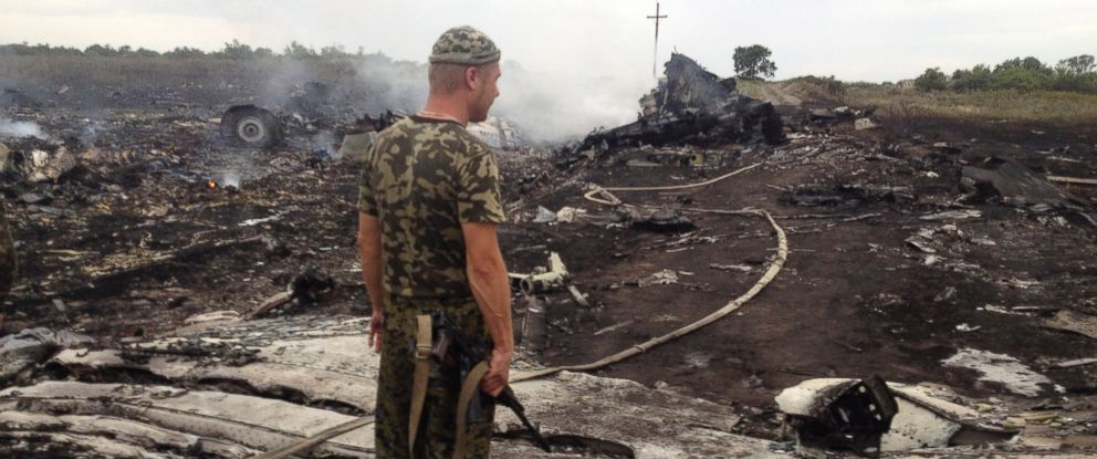 PHOTO: An armed pro-Russian separatist stands at a site of a Malaysia Airlines Boeing 777 plane crash in the settlement of Grabovo in the Donetsk region, July 17, 2014.