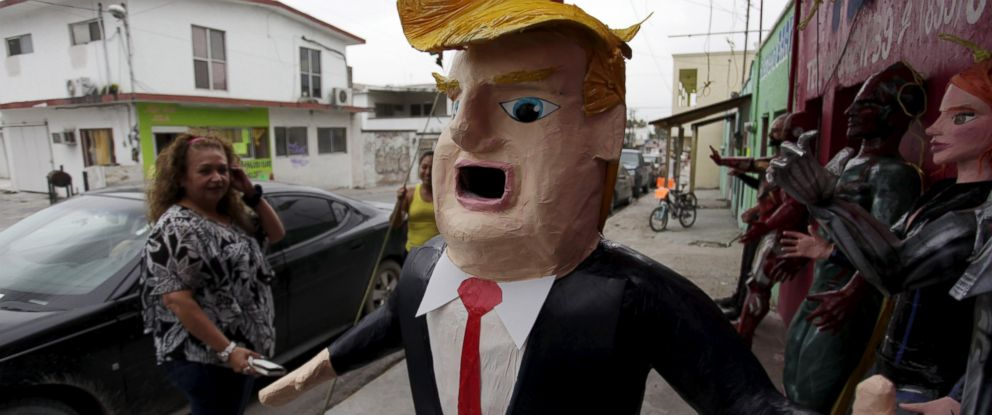 PHOTO: A Mexican client who lives in the U.S., looks at a pinata depicting U.S. Republican presidential candidate Donald Trump hanging outside a workshop in Reynosa, Mexico, June 23, 2015.