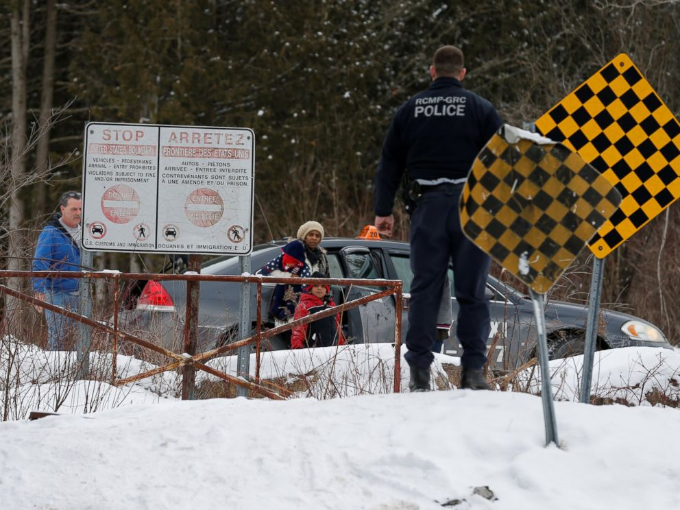 PHOTO: A woman who told police that she and her family were from Sudan is confronted by Royal Canadian Mounted Police officer as she arrives by taxi and attempts to walk across the U.S.-Canada border into Hemmingford, Quebec, Feb. 12, 2017.