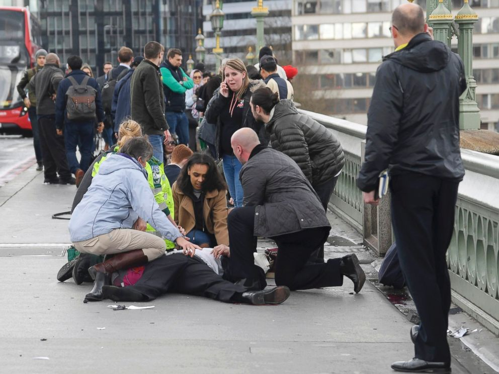 PHOTO: Injured people are assisted after an incident on Westminster Bridge in London, March 22, 2017.