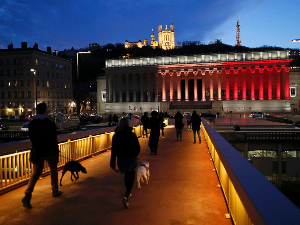 PHOTO: The colors of the Belgian flag are projected on the courthouse in Lyon, France, in tribute to the victims of todays Brussels bomb attacks, March 22, 2016.