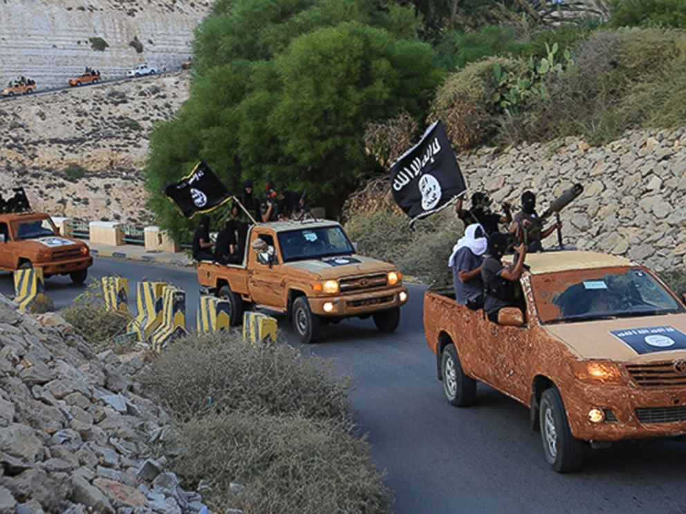 PHOTO: An armed motorcade belonging to members of Dernas Islamic Youth Council drives along a road in Derna in eastern Libya on Oct. 3, 2014.