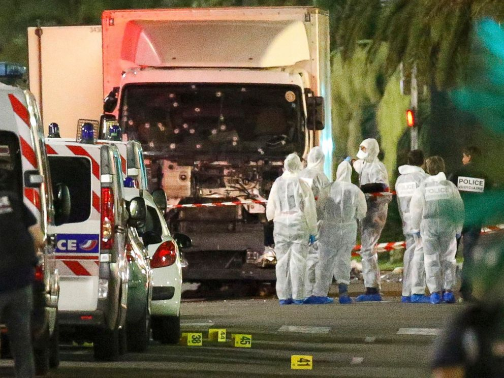 PHOTO: French police forces and forensic officers stand next to a truck that ran into a crowd in Nice, France, July 14, 2016.