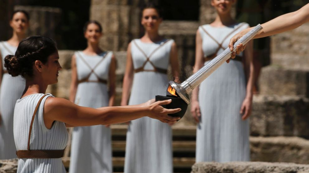 Priestesses attend the Olympic flame lighting ceremony for the Rio 2016 Olympic Games inside the ancient Olympic Stadium on the site of ancient Olympia, Greece, April 21, 2016.