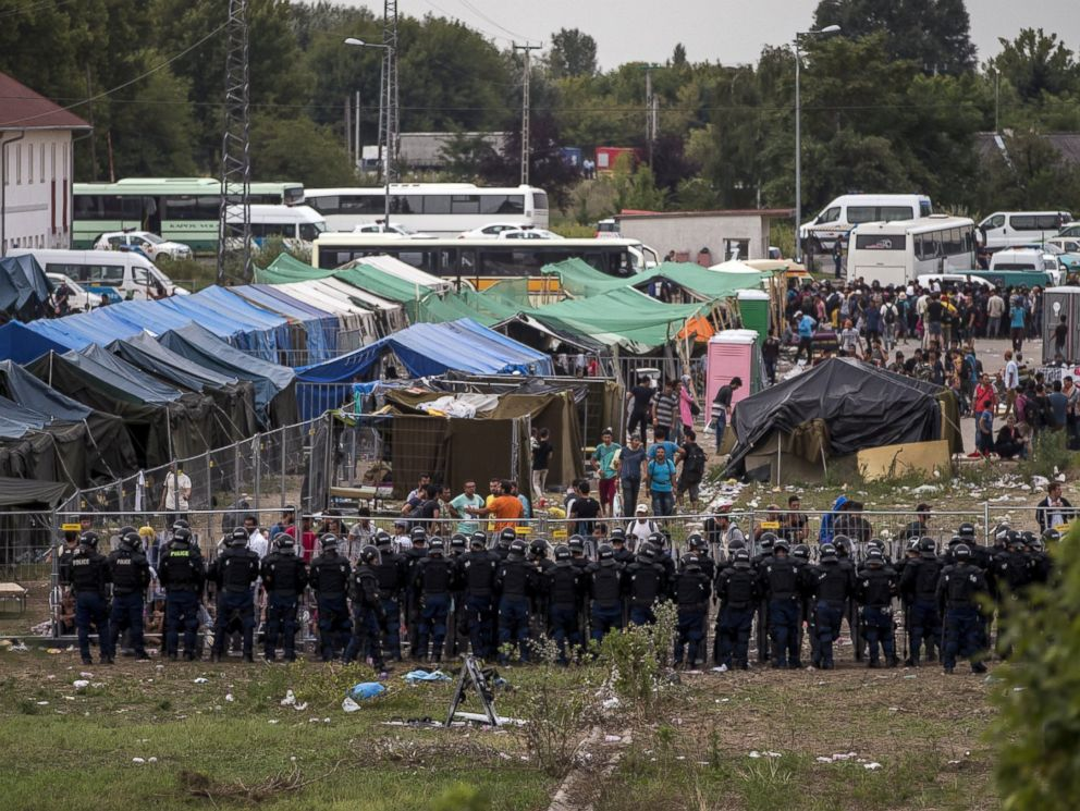 PHOTO: Riot police stand guard in front of a migrant reception centre in Roszke, Hungary, Sept. 4, 2015.