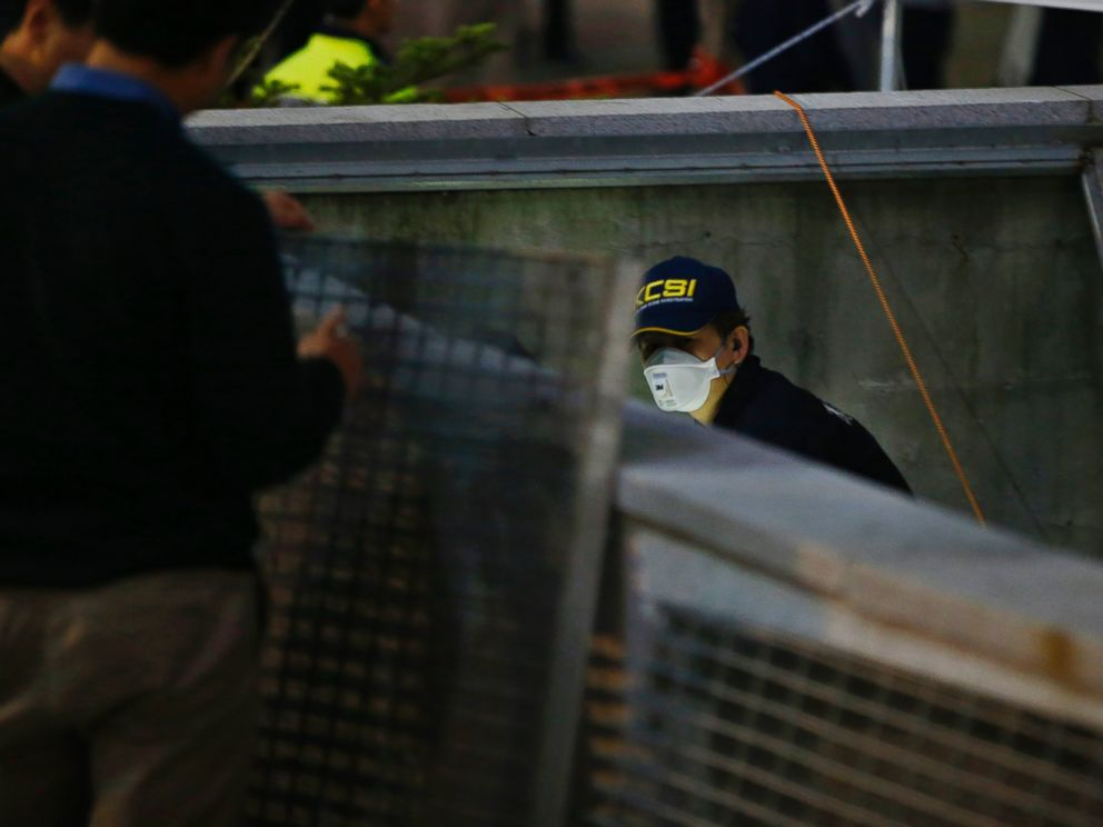 PHOTO: A police official examines the scene of an accident at a shopping district in Seongnam Oct. 17, 2014.