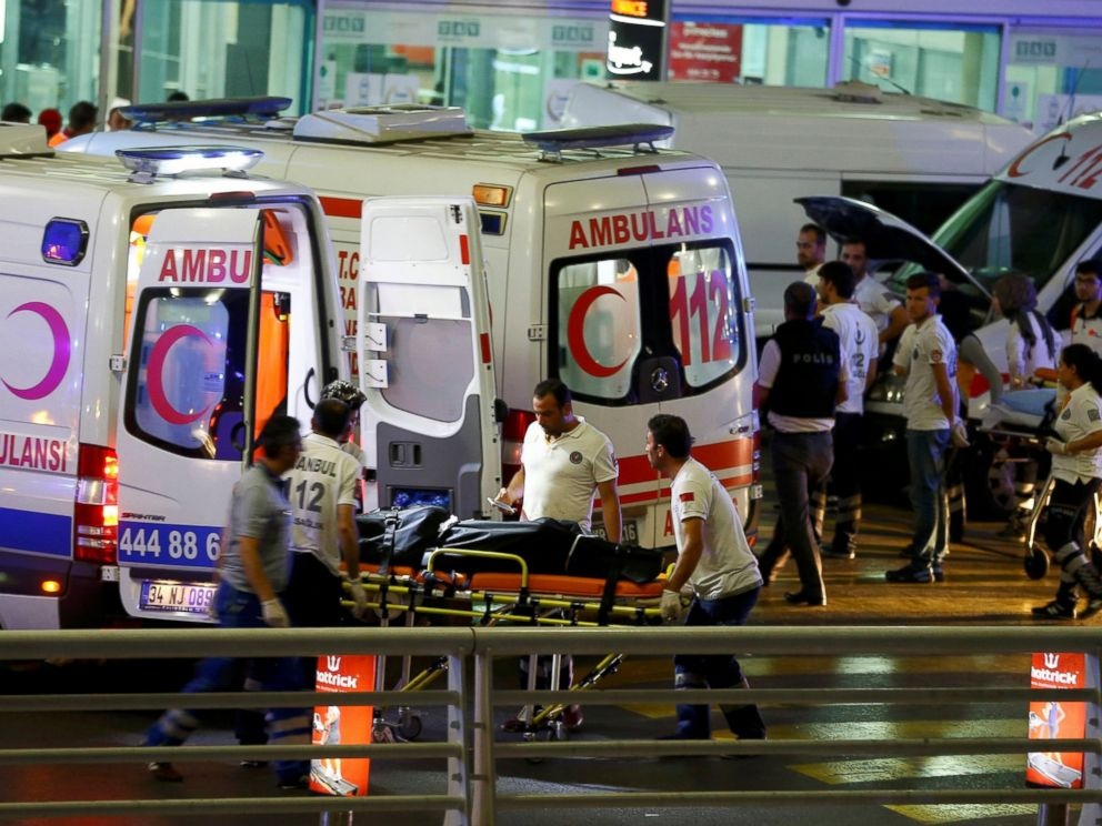 PHOTO: Paramedics push a stretcher at Turkeys largest airport, Istanbul Ataturk, Turkey, following a blast June 28, 2016.