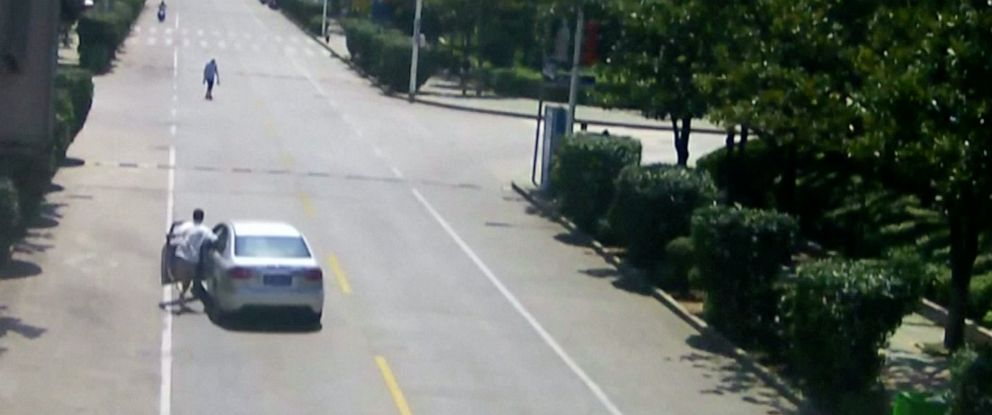 PHOTO: Taxi driver Hu Wengang is seen on surveillance video leaping into an out-of-control vehicle before bringing it to a stop in central Chinas Hubei province on Saturday, July 20, 2019.
