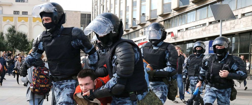 PHOTO: Police officers detain a demonstrator, during an unsanctioned rally in the center of Moscow, Aug. 3, 2019.