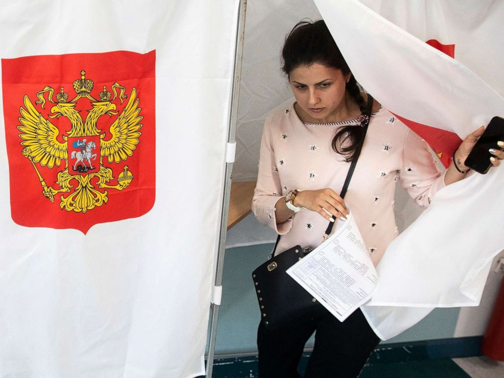 Pavel Golovkin  AP A woman exits a polling booth before casting at a polling station during a city council election in Moscow Sept. 8 2019