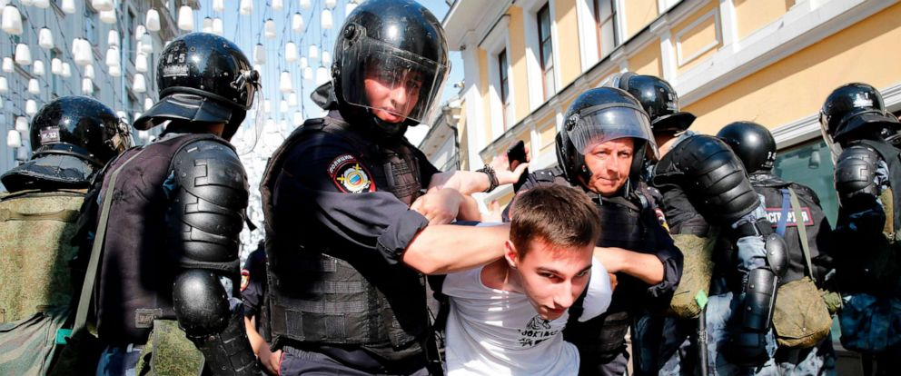 PHOTO: Police officers detain a demonstrator during an unauthorized rally demanding independent and opposition candidates be allowed to run for office in local election in September, in downtown Moscow, July 27, 2019.