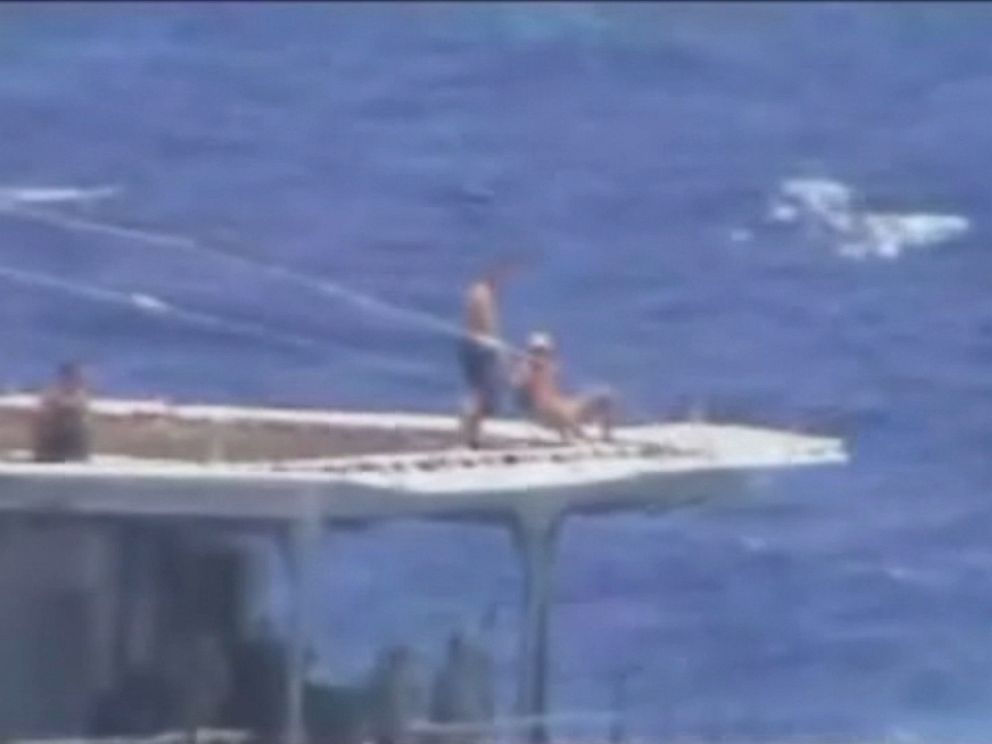 PHOTO: A screen grab from U.S. Navy video shows what appears to be Russian sailors sunbathing on the destroyers helicopter pad.