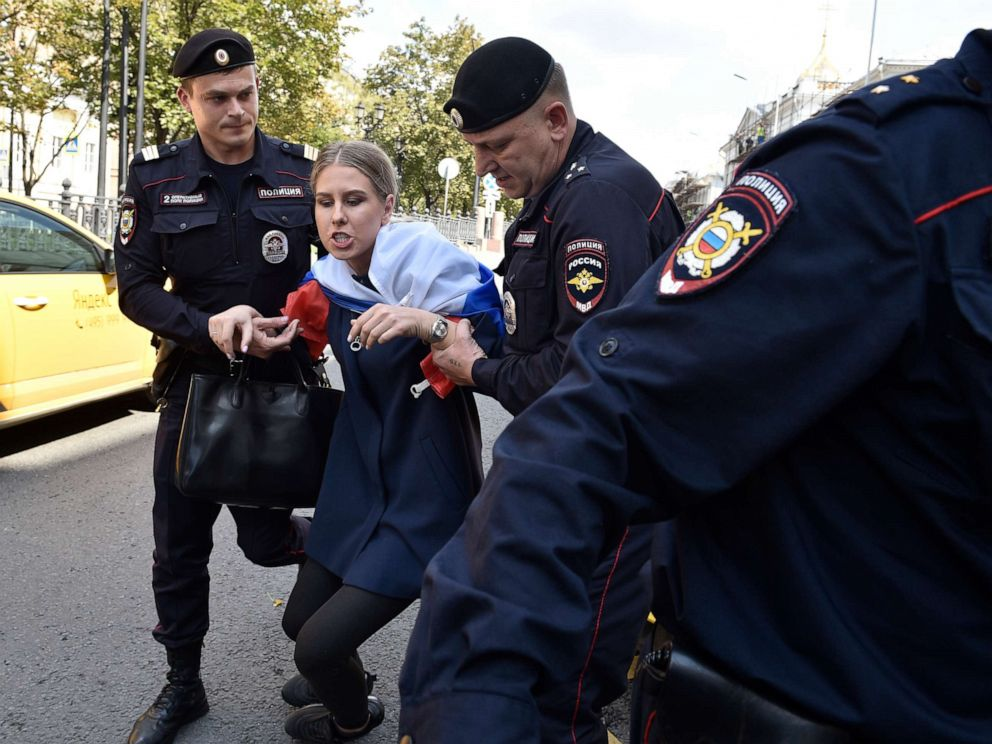 PHOTO:Police officers detain an opposition candidate and lawyer at the Foundation for Fighting Corruption Lyubov Sobol prior to an unsanctioned rally in the center of Moscow, July 27, 2019.