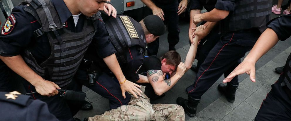 PHOTO: Law enforcement officers arrest a demonstrator at a rally in support of Russian investigative journalist Ivan Golunov, in Moscow, June 12, 2019.