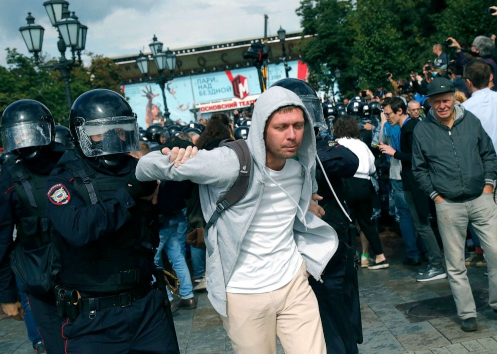 PHOTO: Police officers detain a demonstrator during an unsanctioned rally in Moscow, Aug. 3, 2019.