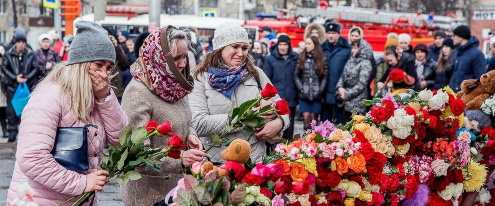 PHOTO: People lay flowers for the victims of a fire in a multi-story shopping center in the Siberian city of Kemerovo, east of Moscow, Russia, March 26, 2018.