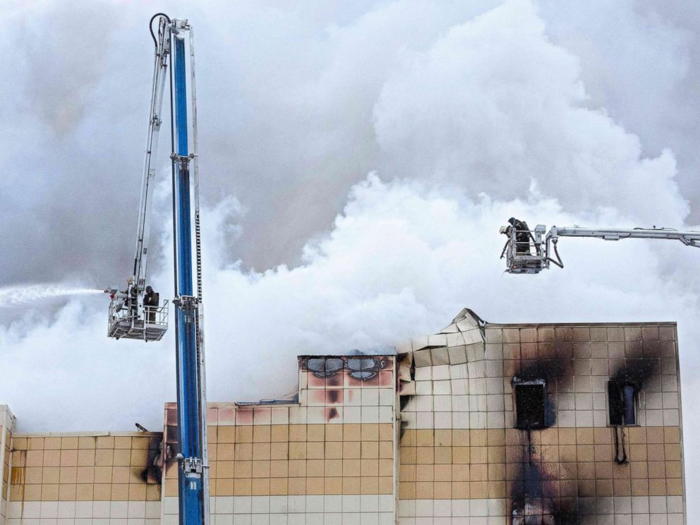 PHOTO: Emergency firefighters extinguish a fire outside a burning shopping center in Kemerovo, Russia, March 25, 2018.