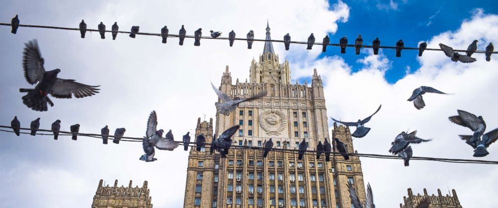 PHOTO: Pigeons take off from wires in front of the Russian Foreign Ministry building, in Moscow, Russia, March 29, 2018.