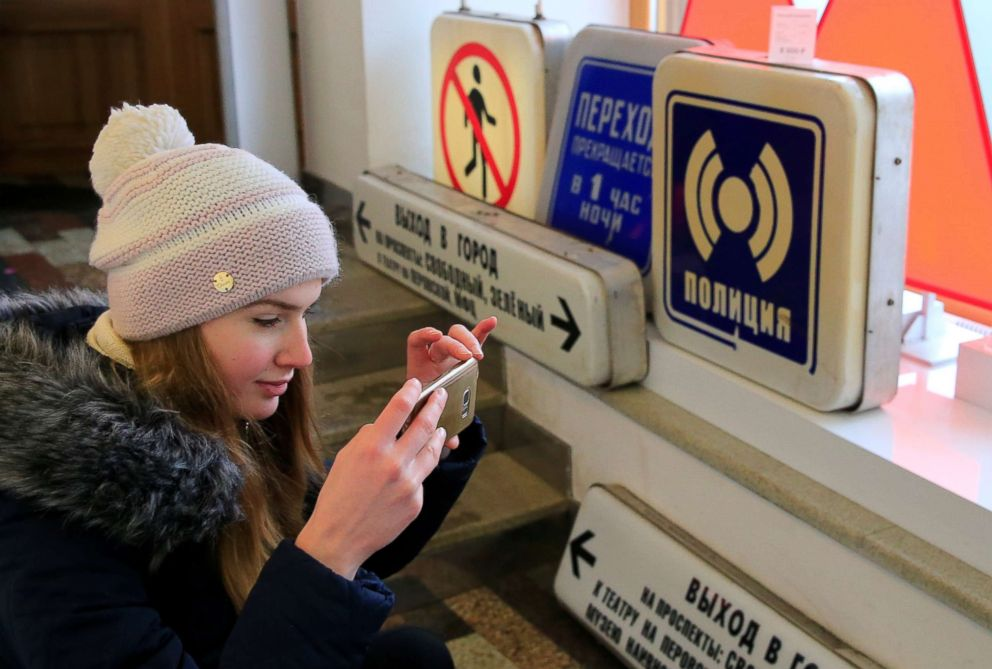 PHOTO: A visitor takes pictures of retro signboards after Moscow metro launched sales of the decommissioned passenger signs at a gift shop in Moscow, Dec. 25, 2018.