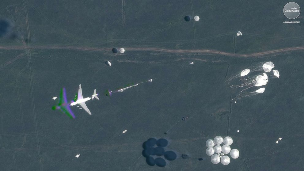 """A satellite image shows parachutes deployed in midair during Russia's """"Vostok 2018"""" military exercises in Tsugol, Russia, on Sep. 13, 2018."""
