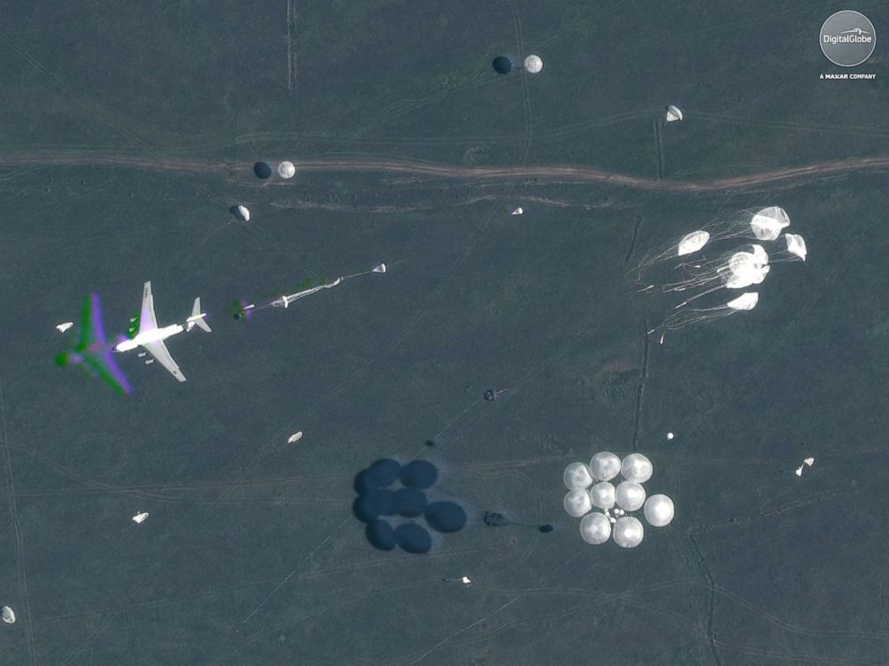PHOTO: A satellite image shows parachutes deployed in midair during Russias Vostok 2018 military exercises in Tsugol, Russia, on Sep. 13, 2018.