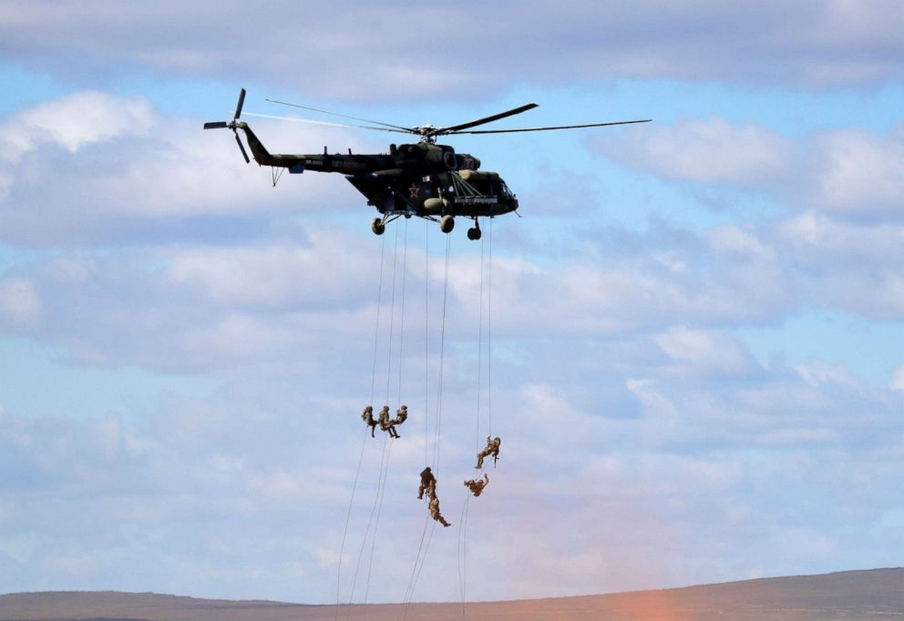 PHOTO: Soldiers rappel from a military helicopter over the training ground Tsugol, north of the city of Chita during the military exercises Vostok 2018 in Eastern Siberia, Russia, Sept. 13, 2018.