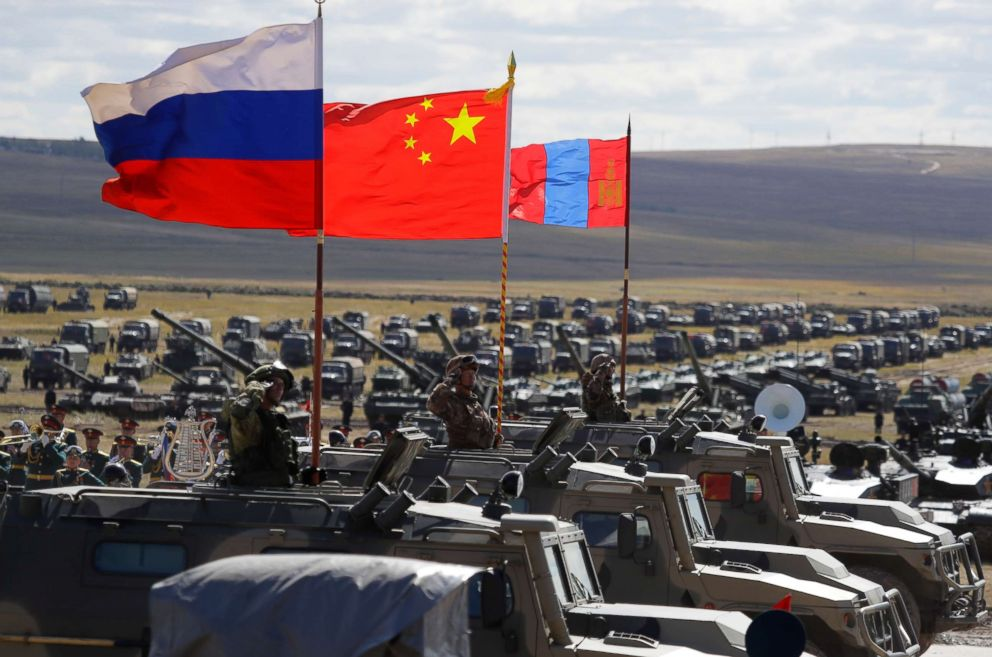 PHOTO: Russian, Chinese and Mongolian national flags set atop armored vehicles during military exercises in Eastern Siberia, Russia, Sept. 13, 2018.