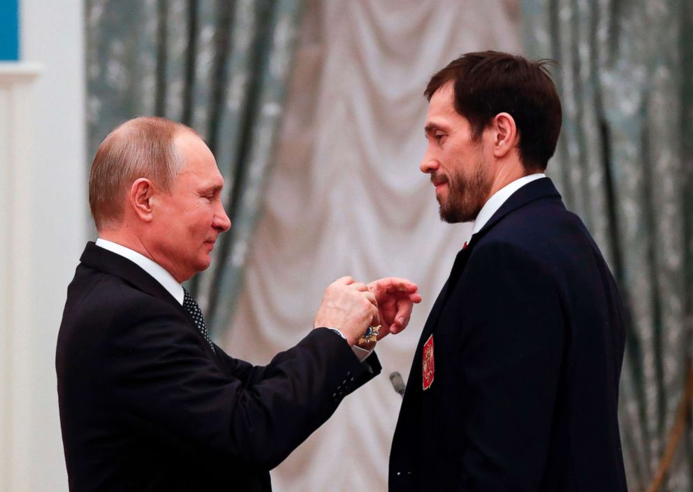 PHOTO: Russian President Vladimir Putin decorates Russian ice hockey player and gold medalist of the 2018 Pyeongchang Winter Olympic Games Pavel Datsyuk with the Order of Friendship during an award ceremony at the Kremlin in Moscow, Feb. 28, 2018.