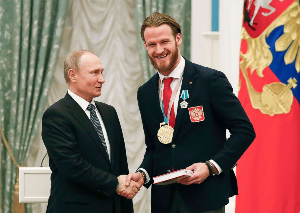 PHOTO: Russian President Vladimir Putin shakes hands with Russian ice hockey player and gold medalist of the 2018 Pyeongchang Winter Olympic Games Ivan Telegin during an award ceremony at the Kremlin in Moscow, Feb. 28, 2018.