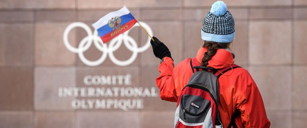 PHOTO: A supporter waves a Russian flag in front of the logo of the International Olympic Committee (IOC) at their headquarters, Dec. 5, 2017, in Pully, Switzerland.
