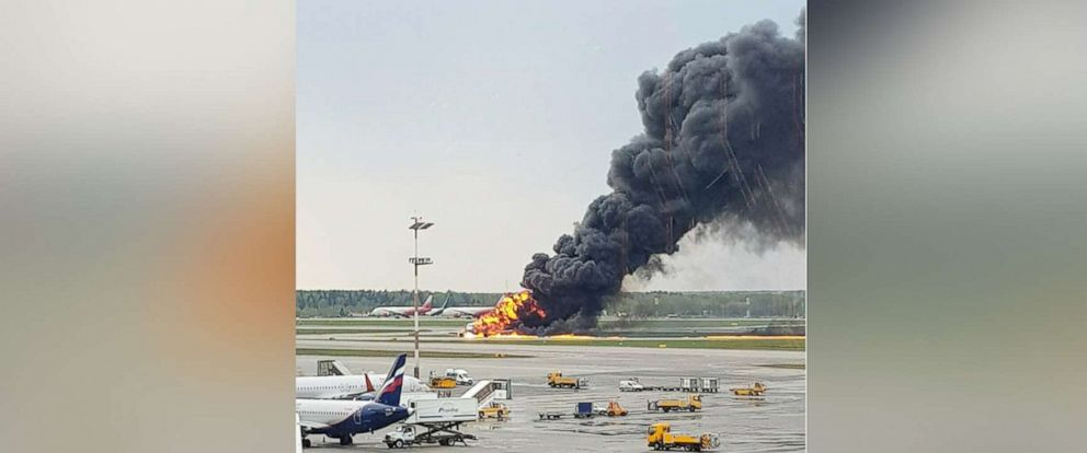 PHOTO: In this image provided by Riccardo Dalla Francesca shows smoke rises from a fire on a plane at Moscows Sheremetyevo airport on Sunday, May 5, 2019.